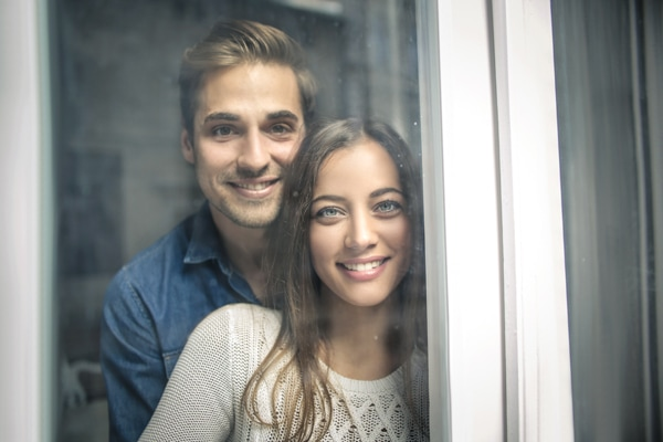 Cheerful couple looking out of the window, Furnace Pressure Switches