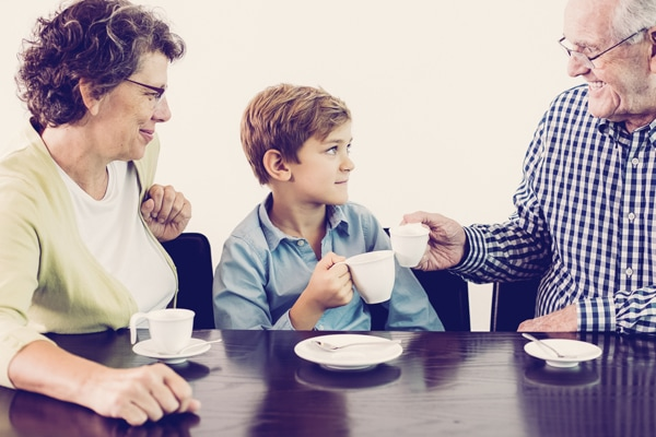 grandparents having tea with their young grandson, Aprilaire indoor air quality products